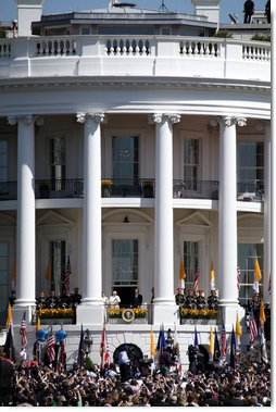 President George W. Bush and Mrs. Laura Bush stand with Pope Benedict XVI as he acknowledges the cheers from the crowd from the South Portico balcony Wednesday, April 16, 2008, on the South Lawn of the White House. White House photo by Grant Miller