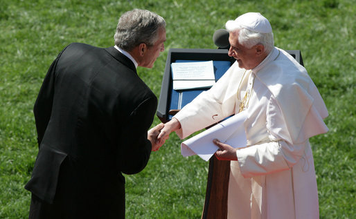 President George W. Bush shakes hands with Pope Benedict XVI following the Pope's remarks Wednesday, April 16, 2008, at the welcoming ceremony for the Pope on the South Lawn of the White House. White House photo by Joyce N. Boghosian