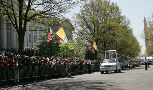 Crowds of people gather outside of the United States Treasury Department to see Pope Benedict XVI as he leaves the White House Wednesday, April 16, 2008, following the arrival ceremony on the South Lawn. White House photo by Patrick Tierney
