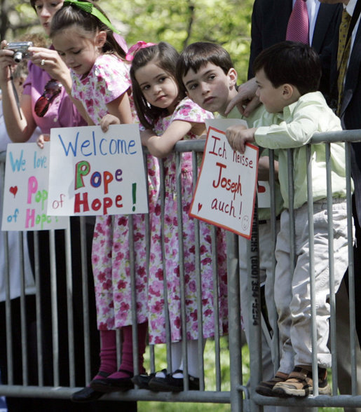 Kids with signs wait for Pope Benedict XVI outside of the United States Treasury Department Wednesday, April 16, 2008, after after the arrival ceremony at the White House. White House photo by Patrick Tierney