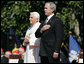 President George W. Bush and Pope Benedict XVI stand together during the playing of the National Anthem at the Pope's welcoming ceremony on the South Lawn of the White House Wednesday, April 16, 2008. White House photo by Shealah Craighead