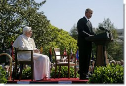 """President George W. Bush delivers remarks Wednesday, April 16, 2008, during the arrival ceremony for Pope Benedict XVI on the South Lawn of the White House. Said the President, """"Holy Father, thank you for making this journey to America. Our nation welcomes you. We appreciate the example you set for the world, and we ask that you always keep us in your prayers.""""  White House photo by David Bohrer"""