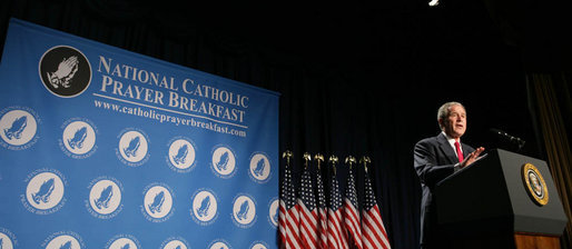 "President George W. Bush smiles as he speaks at the National Catholic Prayer Breakfast Friday, April 18, 2008, at the Washington Hilton Hotel. Speaking about his visit this week with Pope Benedict XVI, the President said, ""The Holy Father strongly believes that to whom much is given much is required -- and he is a messenger of God's call to love our neighbors as we'd like to be loved ourselves."" White House photo by Chris Greenberg"