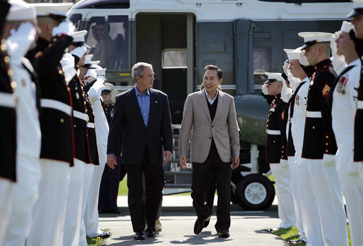 President George W. Bush walks with South Korean President Lee Myung-bak as an honor guard salutes on his arrival Friday, April 18, 2008, at the Presidential retreat at Camp David, Md. White House photo by Shealah Craighead