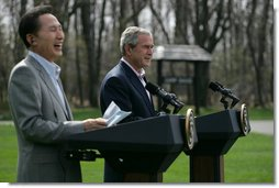 "South Korean President Lee Myung-bak laughs as President George W. Bush speaks of President Lee's nickname the ""Bulldozer"" during a joint press availability Saturday, April 19, 2008, at the Presidential retreat at Camp David, Md. During his remarks, President Bush said, ""President Lee is the first Korean President to visit Camp David. And I don't know if the American citizens understand your nickname -- you're known as the ""Bulldozer."" He said to make sure that it was a bulldozer with a computer. And the reason why is this is a man who takes on big challenges and he doesn't let obstacles get in the way. I like his spirit, I like his candor, and I like his optimistic vision. But most of all I really appreciate his values."" White House photo by Shealah Craighead"