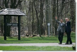 President George W. Bush and South Korean President Lee Myung-bak wave to the press after concluding a joint press availability Saturday, April 19, 2008, at the Presidential retreat at Camp David, Md. White House photo by Shealah Craighead