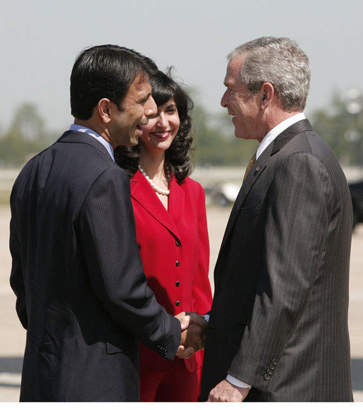 President George W. Bush is greeted by Louisiana Governor Bobby Jindal and his wife, Supriya Jolly Jindal, on his arrival to Louis Armstrong New Orleans International Airport Monday, April 21, 2008, where President Bush will attend the 2008 North American Leaders' Summit. White House photo by Joyce N. Boghosian