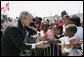 President George W. Bush shakes hands with students from New Orleans area schools upon his arrival to Louis Armstrong New Orleans International Airport Monday, April 21, 2008, where President Bush will attend the 2008 North American Leaders' Summit. White House photo by Joyce N. Boghosian