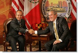 President George W. Bush and Mexico's President Felipe Calderon shake hands in their first meeting to discuss issues Monday, April 21, 2008, during the 2008 North American Leaders' Summit in New Orleans.  White House photo by Chris Greenberg