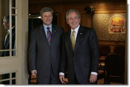 President George W. Bush and Canadian Prime Minister Stephen Harper arrive for their first meeting of the 2008 North American Leaders' Summit Monday, April 21, 2008, at the Windsor Court Hotel in New Orleans. White House photo by Joyce N. Boghosian