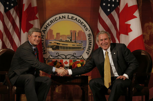 President George W. Bush and Canadian Prime Minister Stephen Harper shake hands in their first meeting to discuss issues Monday, April 21, 2008, during the 2008 North American Leaders' Summit in New Orleans. White House photo by Joyce N. Boghosian