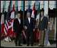 President George W. Bush joins Mexico's President Felipe Calderon and Canadian Prime Minister Stephen Harper as they pose for photographers outside the Commander's Palace restaurant Monday evening, April 21, 2008, before attending the North American Leaders' Summit dinner in New Orleans. White House photo by Joyce N. Boghosian