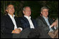 President George W. Bush joins Mexico's President Felipe Calderon and Canadian Prime Minister Stephen Harper, right, as they listen to a jazz band at the Commander's Palace restaurant Monday evening, April 21, 2008, after attending the North American Leaders' Summit dinner in New Orleans. White House photo by Joyce N. Boghosian