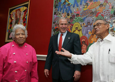 President George W. Bush is welcomed to Dooky Chase's restaurant Tuesday morning, April 22, 2008 in New Orleans, by owners Leah and Dooky Chase, where President Bush hosted a breakfast meeting with President Felipe Calderon of Mexico and Canadian Prime Minister Stephen Harper during the final day of the 2008 North American Leaders' Summit. White House photo by Joyce N. Boghosian