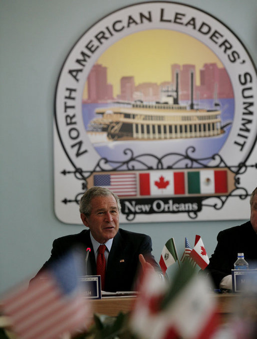 President George W. Bush addresses a meeting of the North American Competitiveness Council Tuesday, April 22, 2008 in New Orleans, attended by Mexico's President Felipe Calderon and Canada's Prime Minster Stephen Harper, along with international business leaders at the 2008 North American Leaders' Summit. White House photo by Joyce N. Boghosian