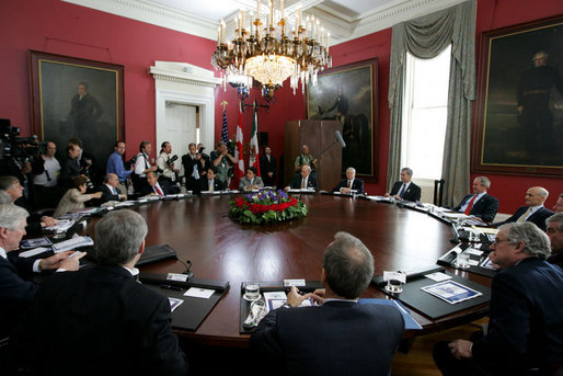 President George W. Bush, right, participates in a trilateral meeting Tuesday, April 22, 2008 in New Orleans, with Mexico's President Felipe Calderon and Canada's Prime Minster Stephen Harper and their delegations at the 2008 North American Leaders' Summit. White House photo by Joyce N. Boghosian