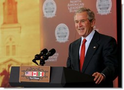 President George W. Bush smiles in response to a reporter's question at a joint news conference Tuesday, April 22, 2008, with Mexico's President Felipe Calderon and Canada's Prime Minster Stephen Harper on the last day of the 2008 North American Leaders' Summit in New Orleans. White House photo by Chris Greenberg