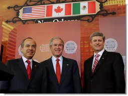 President George W. Bush, Mexico's President Felipe Calderon and Canadian Prime Minster Stephen Harper stand together at the conclusion of their joint news conference Tuesday, April 22, 2008, the last day of the 2008 North American Leaders' Summit in New Orleans. White House photo by Joyce N. Boghosian