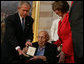 "President George W. Bush presents the Congressional Gold Medal to famed heart surgeon Dr. Michael Ellis DeBakey during a ceremony Wednesday, April 23, 2008, at the U.S. Capitol. Said the President, ""For nearly a hundred years, our country has been blessed with the endless talents and dedication of Dr. Michael DeBakey. And he has dedicated his career to a truly noble ambition -- bettering the life of his fellow man."" White House photo by Chris Greenberg"