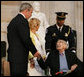 President George W. Bush offers his hand to Dr. Michael DeBakey Wednesday, April 23, 2008, after honoring the 99-year-old pioneer of bypass heart surgery during the Congressional Gold Medal Ceremony at the U.S. Capitol. White House photo by Chris Greenberg