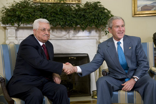President George W. Bush shakes hands with President Mahmoud Abbas as they meet with the media Thursday, April 24, 2008, in the Oval Office of the White House. White House photo by Chris Greenberg