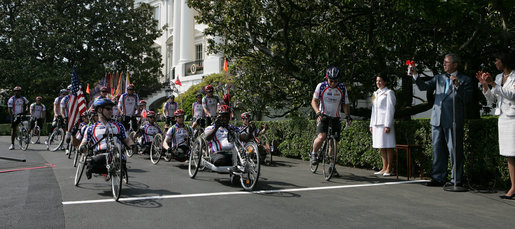 President George W. Bush sounds the horn to kick off the Wounded Warriors Soldier Ride Thursday, April 24, 2008, on the South Lawn drive at the White House. With him is Secretary of State Condoleezza Rice. White House photo by Chris Greenberg