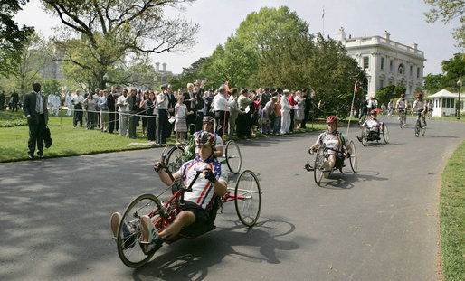 "Members of the Wounded Warrior Project's Soldier Ride ride along the South Lawn drive at the White House Thursday, April 24, 2008, during the kick off of the annual ""Soldier Ride: White House to Lighthouse Challenge"" bike ride. White House photo by Joyce N. Boghosian"