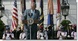 President George W. Bush smiles as he delivers remarks to the Members of the Wounded Warrior Project's Soldier Ride Thursday, April 24, 2008, on the South Lawn of the White House. The ride provides rehabilitative cycling events for severely injured service members, affording many of the combat-wounded veterans a way to return to an active lifestyle.  White House photo by Patrick Tierney