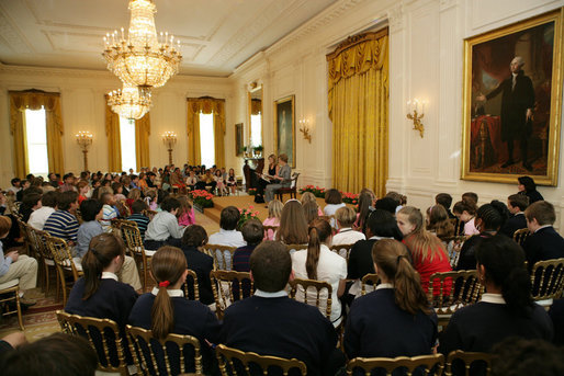 Mrs. Laura Bush and daughter, Jenna Bush, read a book to children of White House staff at Bring Your Child to Work Day Thursday, April 24, 2008, in the East Room of the White House. White House photo by Shealah Craighead