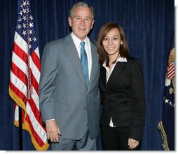 "President George W. Bush stands backstage with Yadira Vieyra, a Georgetown University student, who was among those in attendance Thursday, April 24, 2008, at the White House Summit on Inner-City Children and Faith-Based Schools. The President mentioned Yadira in his remarks to the summit, saying: "".Let me end with a story here about Yadira Vieyra. Yadira says she goes to Georgetown University, and she said -- I was asking if Yadira was going to be here so I could ask her to stand here in a minute, and a fellow told me she's a little worried about missing class. So whoever Yadira's teacher is, please blame it on me, not her.""  White House photo by Chris Greenberg"
