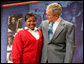 "President George W. Bush stands with his arm around Aysia Mayo-Gray, a student at St. Ann's Academy in Washington, D.C., and one of the greeters on hand to welcome the President to the White House Summit on Inner-City Children and Faith-Based Schools Thursday, April 24, 2008, at the Ronald Reagan Building and International Trade Center. Said the President after being introduced by the 14-year-old, ""Aysia, thanks for the introduction -- you did a fabulous job. I'm told that your's a very hard worker who loves school, and it's clear you always wear a smile."" White House photo by Chris Greenberg"