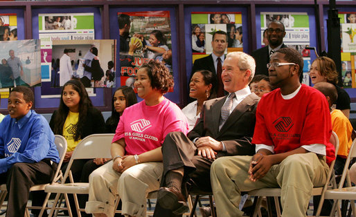 President George W. Bush joins members at the Northwest Boys & Girls Club in Hartford, Conn., Friday, April 25, 2008, during a program presentation for Malaria Awareness Day. President Bush later reviewed projects that the Boys & Girls Club members made about the prevention and treatment of malaria. White House photo by Chris Greenberg