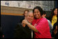 President George W. Bush is embraced by Boys and Girls Club member Melodie Williams as they pose for a photo Friday, April 25, 2008, during the President's visit to the Northwest Boys & Girls Club in Hartford, Conn., where the Boys & Girls members were learning about the cause and prevention of malaria. White House photo by Chris Greenberg