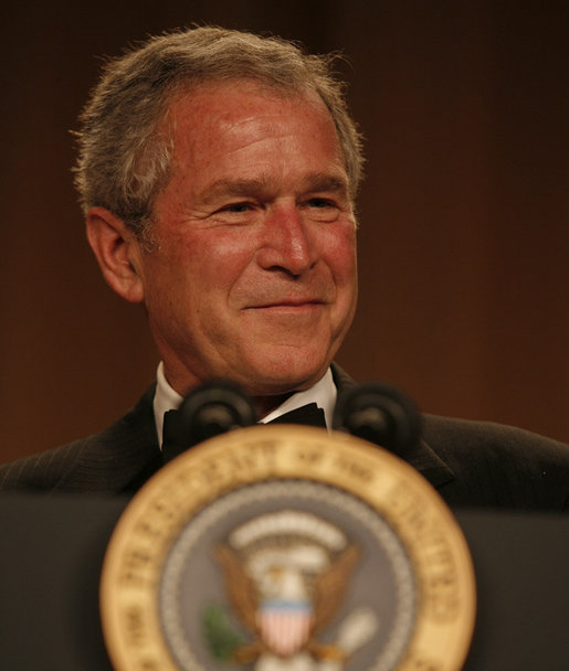 President George W. Bush smiles as he delivers remarks Saturday evening, April 26, 2008, during the White House Correspondents' Association Dinner at the Washington Hilton Hotel. White House photo by Joyce N. Boghosian