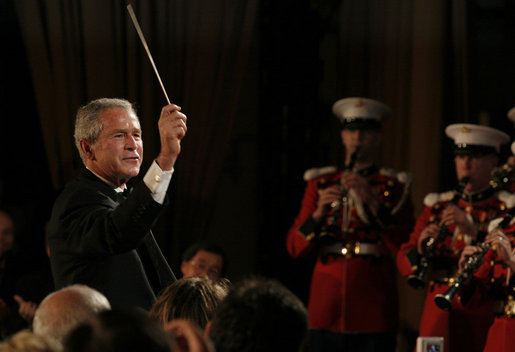 President George W. Bush leads the Marine Band Saturday, April 26, 2008, during the 94th Annual White House Correspondents' Association Dinner at the Washington Hilton Hotel. White House photo by Joyce N. Boghosian