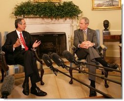 President George W. Bush listens to remarks by President Alvaro Colom Monday, April 28, 2008, in the Oval Office during a visit the Guatemalan leader and his wife to the White House. White House photo by Chris Greenberg