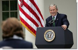 President George W. Bush laughs as he takes a question from a journalist Tuesday, April 29, 2008, during a news conference in the Rose Garden of the White House.  White House photo by Shealah Craighead