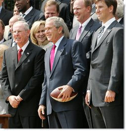President George W. Bush smiles as he holds a football presented to him by New York Giants Coach Tom Coughlin and Quarterback Eli Manning Wednesday, April 30, 2008, during an event on the South Lawn celebrating the Giants 17-14 Super Bowl win in February. White House photo by Chris Greenberg