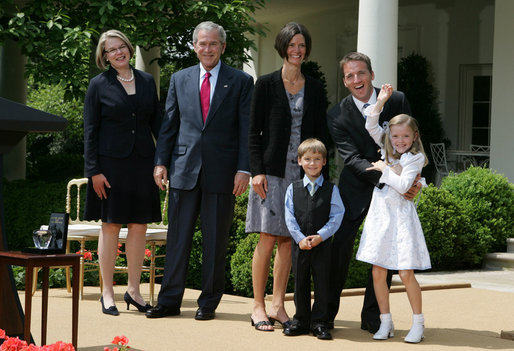 President George W. Bush and Secretary of Education Margaret Spellings join Mike Geisen, the 2008 National Teacher of the Year, and his family as they celebrate the 7th grade teacher's honors Wednesday, April 30, 2008, in the Rose Garden of the White House. Family members include Mr. Geisen's wife, Jennifer, and their children, Johanna, 8, and Aspen, 6. White House photo by Joyce N. Boghosian