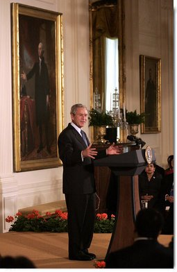 "President George W. Bush delivers remarks during the Celebration of Asian Pacific American Heritage Month Thursday, May 1, 2008, in the East Room of the White House. ""More than 15 million Americans claim Asian or Pacific ancestry. They make America's culture more vibrant, and we're a better place and a more lively place,"" President Bush stated during his remarks. White House photo by Grant Miller"