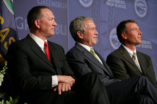 President George W. Bush shares a smile with Greensburg Schools Superintendent Darin Headrick, (left), and Greensburg High Principal Randy Fulton, during commencement ceremonies for the Greensburg High School graduating class of 2008. The town of Greensburg, KS was almost entirely destroyed when a tornado tore through the town one year ago today. White House photo by Chris Greenberg