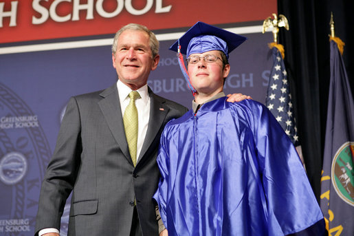 President George W. Bush shares a smile with Aaron Widner after presenting him with his diploma during commencement ceremonies for the Greensburg High School Class of 2008. Aaron has enlisted in the United States Marine Corps and will be attending Basic Training in the months to come. The town of Greensburg, KS was almost entirely destroyed when a tornado tore through the town one year ago today. White House photo by Chris Greenberg