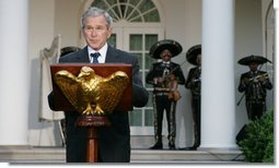 President George W. Bush welcomes guests to the Rose Garden Monday evening, May 5, 2008, for a social dinner in honor of Cinco de Mayo. White House photo by Chris Greenberg
