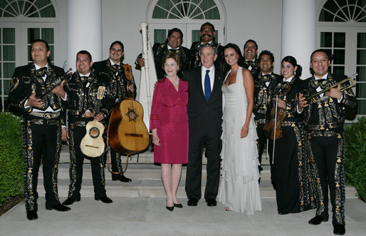 President George W. Bush and Laura Bush pose for photos with singer Shaila Durcal, Dorio Ferreira Sanchez and the Mariachi Campanas de America following their performance in the Rose Garden Monday evening, May 5, 2008, during a social dinner at the White House in honor of Cinco de Mayo. White House photo by Chris Greenberg