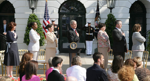 President George W. Bush stands for the national anthem with recipients of the President's Volunteer Service Award during Military Spouse Day ceremonies Tuesday, May 6, 2008, on the South Lawn of the White House. White House photo by Chris Greenberg