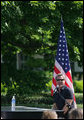 Country recording artist Phil Vassar sings the national anthem Tuesday, May 6, 2008, during Military Spouse Day celebration on the South Lawn of the White House. White House photo by Chris Greenberg