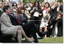 The cameras are turned to President George W. Bush as he sits with Ellen Patton, left, and Colleen Saffron, two of the six recipients of the President's Volunteer Service Award, during Military Spouse Day ceremonies Tuesday, May 6, 2008, on the South Lawn of the White House.  White House photo by Joyce N. Boghosian