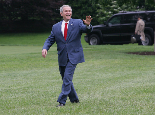 President George W. Bush smiles as he walks across the South Lawn to Marine One Thursday, May 8, 2008, en route to Andrews Air Force Base before continuing on to the Bush Ranch where he and Mrs. Laura Bush will celebrate the wedding of their daughter, Jenna, Saturday. White House photo by Joyce N. Boghosian