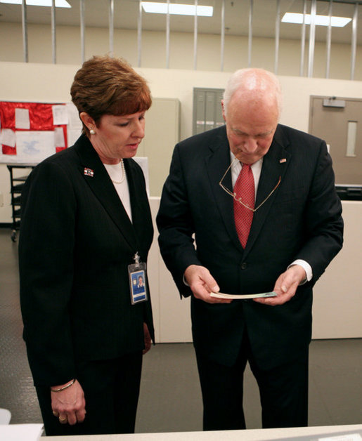 Vice President Dick Cheney examines an economic stimulus check Thursday, May 8, 2008, while on a tour of the Philadelphia Regional Financial Center with Director Betty Belinsky in Philadelphia. From May through July the Philadelphia Regional Financial Center will print over 42 million checks for disbursement to U.S. citizens as part of the Economic Stimulus Act of 2008. White House photo by David Bohrer