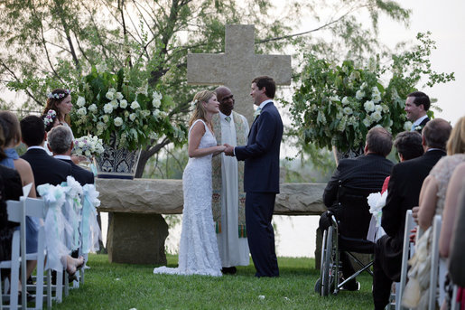 Henry Hager and Jenna Bush exchange vows at the altar Saturday, May 10, 2008, during their wedding ceremony at Prairie Chapel Ranch near Crawford, Texas. Presiding over the ceremony is the Rev. Kirbyjon Caldwell of Houston's Windsor Village United Methodist Church. White House photo by Shealah Craighead